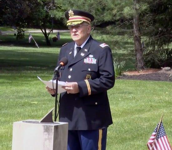 In this image captured from Hudson public access television, retired Army Lt. Col. Barnard Kemter gives a Memorial Day speech in Hudson.