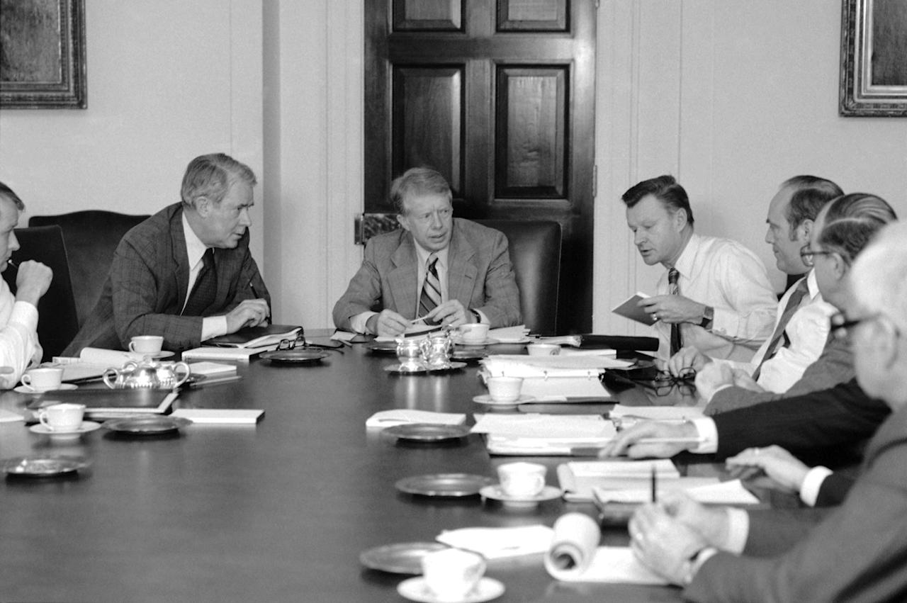 <p>President Jimmy Carter met with his top advisors and American delegation to the Mideast peace talks in the Cabinet Room of the White House in Washington on Friday, March 2, 1979. The President is planning to meet with Prime Minister Begin again on Saturday. From left are Secretary of State Cyrus Vance, Carter, and National Security Advisor Zbigniew Brzezinski. (Photo: Ira Schwarz/AP) </p>