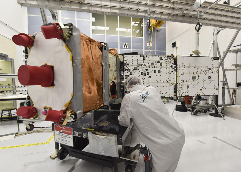 Ball Aerospace engineer works on GPIM, a small satellite built for NASA, during solar array deployment
