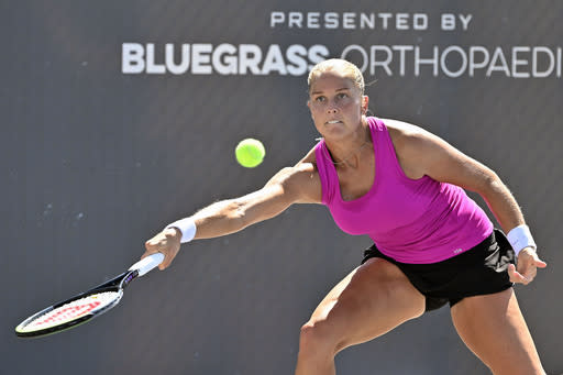 Shelby Rogers reaches for a shot during action in her WTA tennis tournament match against Serena Williams in Nicholasville, Ky., Friday, Aug. 14, 2020. (AP Photo/Timothy D. Easley)