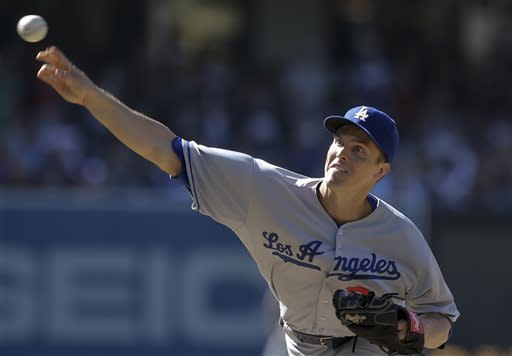 Los Angeles Dodgers starting pitcher Zack Greinke releases a pitch against the San Diego Padres during the first inning of a baseball game in San Diego, Saturday, June 22, 2013. (AP Photo/Lenny Ignelzi)