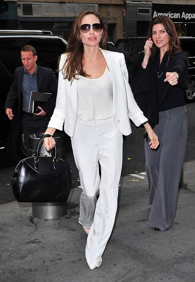"Angelina Jolie looked effortlessly chic while stepping out in the Big Apple on Monday wearing an all-white Stella McCartney ensemble consisting of a blazer, silk camisole, and wide-legged pants. The actress, who has been making the rounds to promote her new flick, ""In the Land of Blood and Honey,"" accessorized with a black Ralph Lauren ""Bedford"" bag and aviator shades. (12/05/2011)"