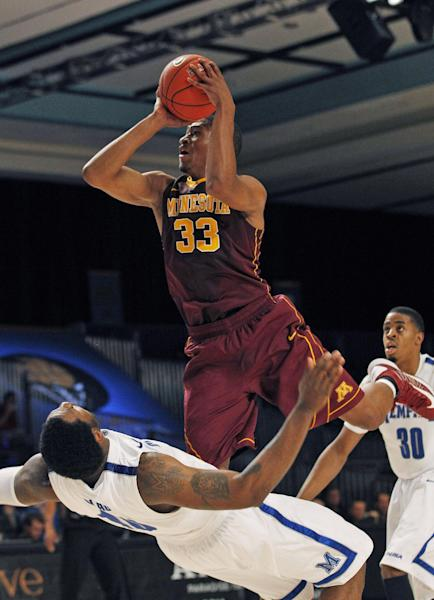 Minnesota forward Rodney Williams Jr. (33) shoots over Memphis forward Tarik Black (10) during the first half of an NCAA college basketball game at the Battle 4 Atlantis tournament, Friday, Nov. 23, 2012 in Paradise Island, Bahamas. (AP Photo/John Bazemore)