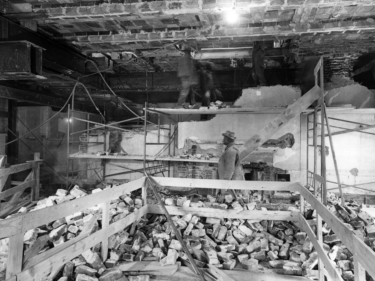 Photos of a White House gut renovation workmen removing wall april 1950
