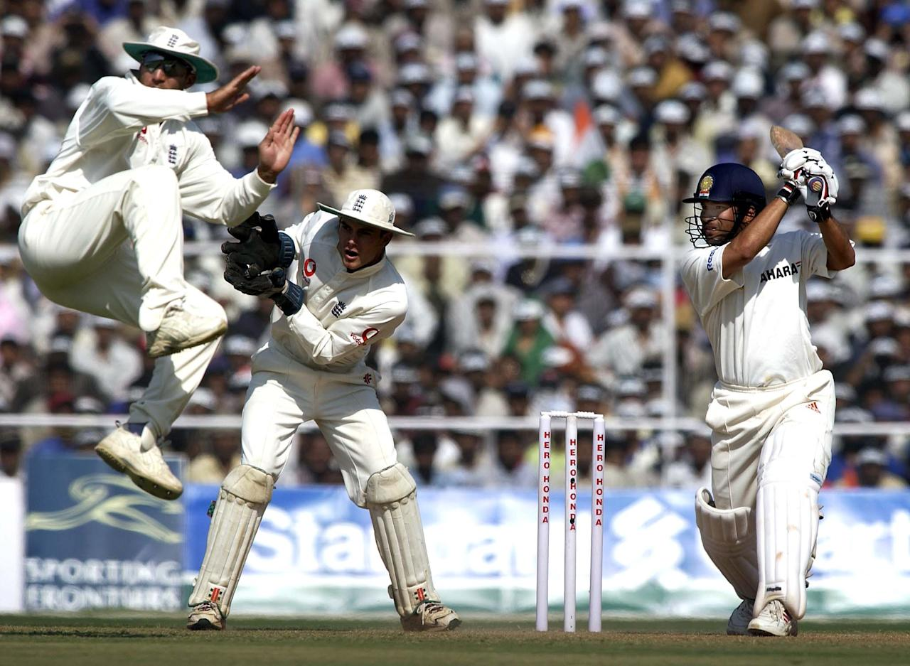 13 Dec 2001:  Sachin Tendulkar of India hits out on his way to a century as Mark Butcher of England takes evasive action during the third day of the 2nd Test between England and India at the Sardar Patel Gujarat Stadium in Ahmedabad, India. DIGITAL IMAGEMandatory Credit: Tom Shaw/ALLSPORT