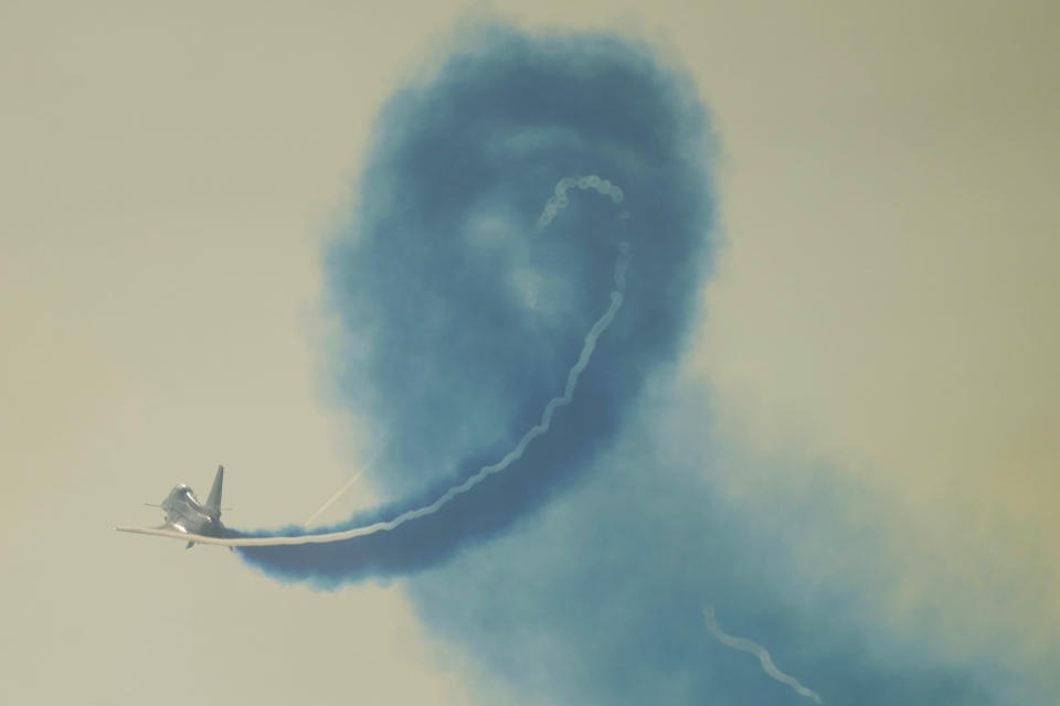 """A member of the """"August 1st"""" Aerobatic Team of the Chinese People's Liberation Army (PLA) Air Force performs during the 13th China International Aviation and Aerospace Exhibition, also known as Airshow China 2021, on Tuesday, Sept. 28, 2021 in Zhuhai in southern China's Guangdong province. (AP Photo/Ng Han Guan)"""