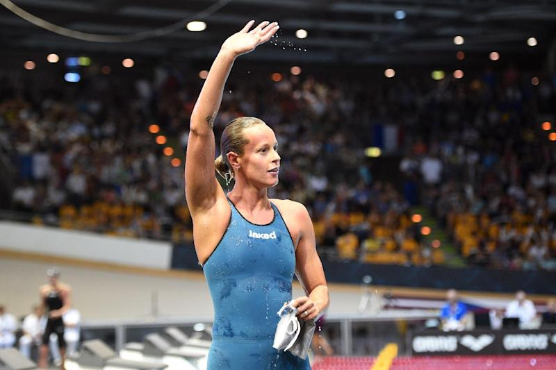 Italy's Federica Pellegrini celebrates winning the women's 200m freestyle final of the 32nd LEN European Swimming Championships on August 23, 2014 in Berlin (AFP Photo/Damien Meyer)