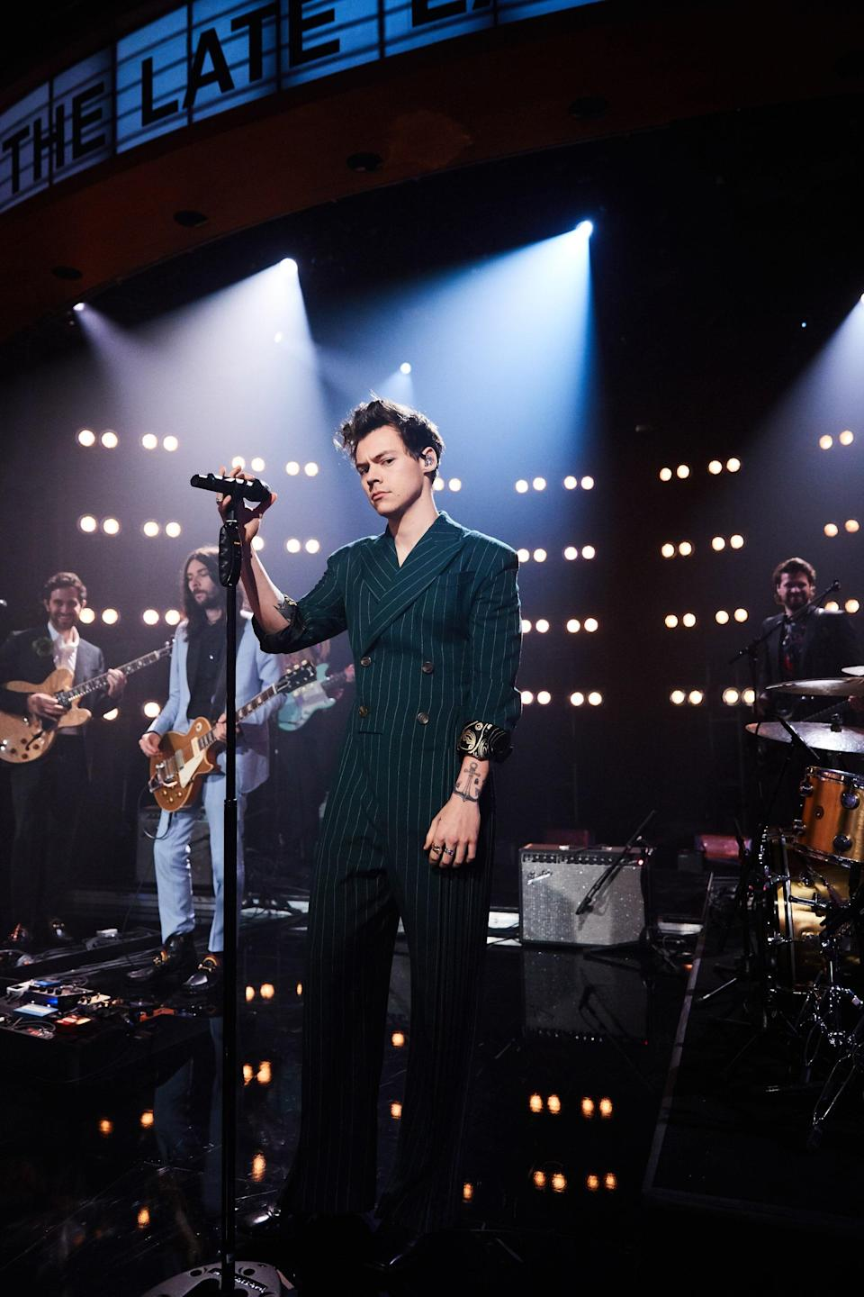 "Seeing Harry perform ""Kiwi"" live solidified his modern rockstar title, and this green pinstripe Charles Jeffrey Loverboy jumpsuit he wore for it at ""The Late Late Show with James Corden"" was the perfect accompanying 'fit."