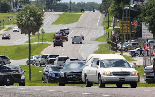 <p>The funeral procession of Miguel Angel Honorato heads up South Orange Blossom Trail after departing St. Francis of Assisi Catholic Church, in Apopka, Fla., north of Orlando, Tuesday, June 21, 2016. (Joe Burbank/Orlando Sentinel via AP) </p>