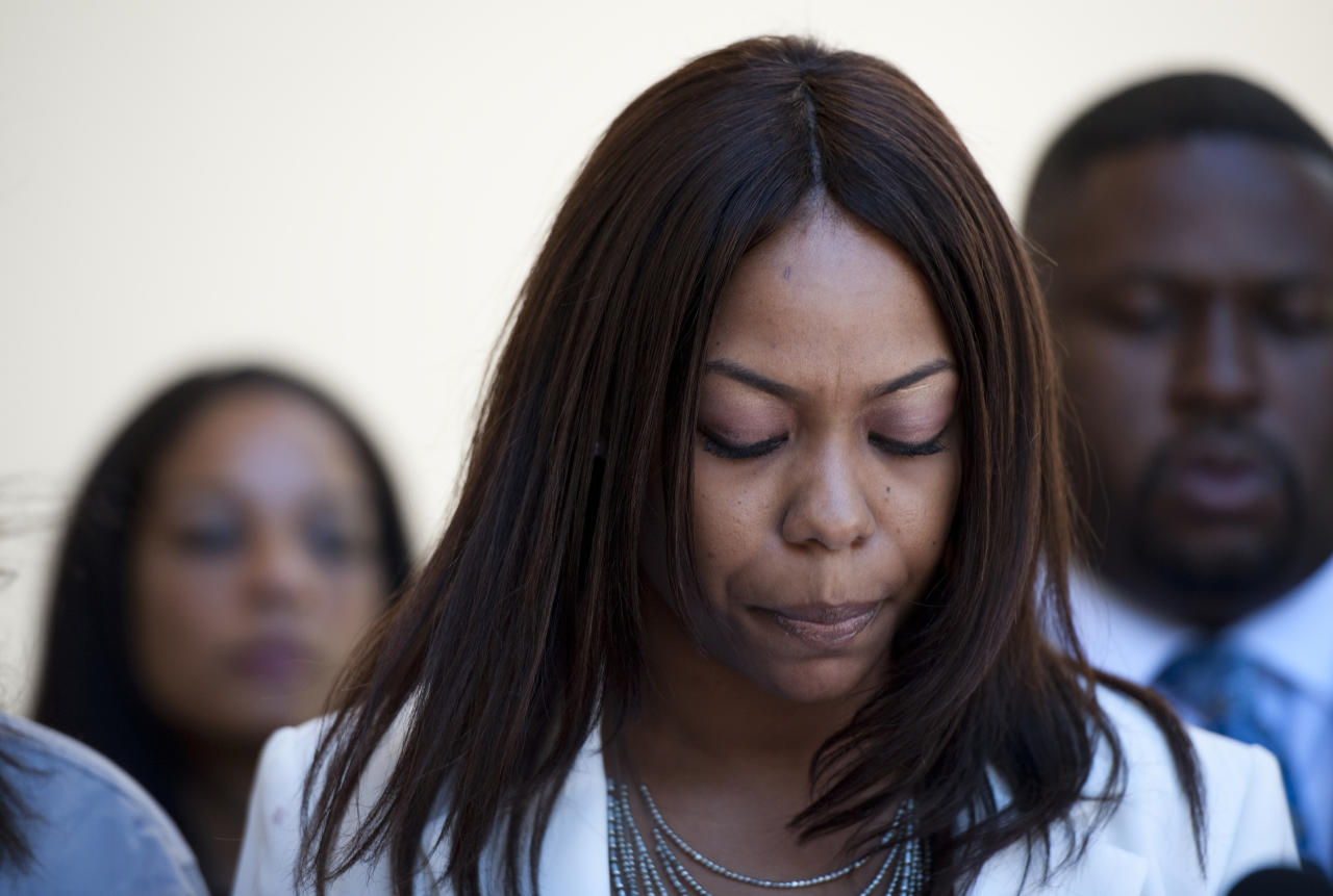 One of Rodney King's daughters, Laura Dene King, speaks to reporters before the public memorial service for her father at Forest Lawn-Hollywood Hills in Los Angeles on Saturday, June 30, 2012. King passed away earlier this month at 47. (AP Photo/Grant Hindsley)