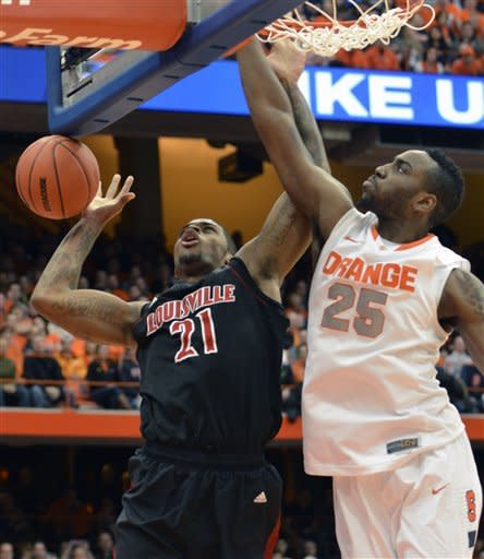 Louisville's Chane Behanan, left, has the ball knock away by Syracuse's Hakeem Christmas during the first half of an NCAA college basketball game in Syracuse, N.Y., Saturday, March 2, 2013. (AP Photo/Kevin Rivoli)