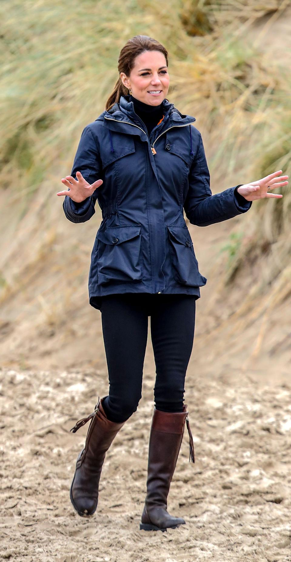 During her day of engagements in North Wales, Kate swapped her red Philosophy by Lorenzo Serafini blazer for a new wax parka by Troy London. She swapped her Aquatalia boots for her trusty Penelope Chilvers pair. [Photo: Getty]