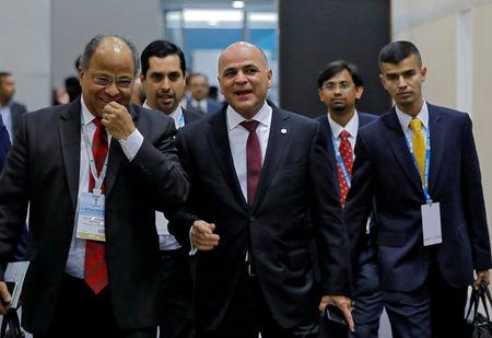 FILE PHOTO: Venezuela's Oil Minister and President of Venezuelan state-run oil company PDVSA Manuel Quevedo (C) arrives to attend the Petrotech conference in Greater Noida, India, February 11, 2019. REUTERS/Anushree Fadnavis/File Photo