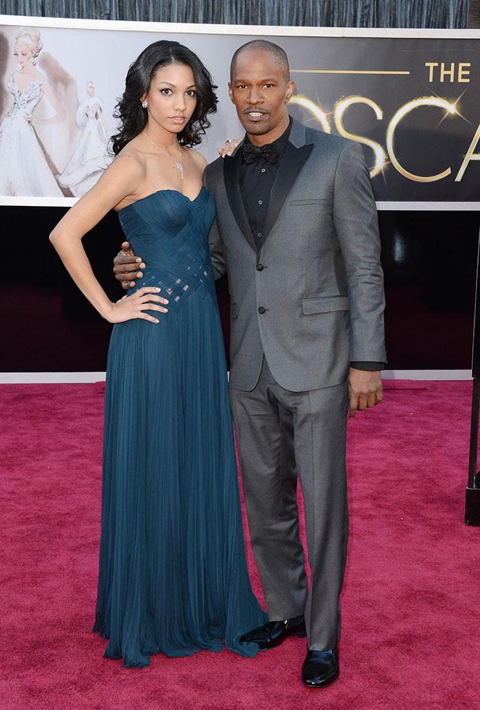 Jamie Foxx and daughter Corinne Bishop arrive at the Oscars in Hollywood, California, on February 24, 2013.