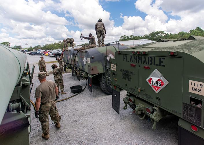 South Carolina National Guard soldiers transfer bulk diesel fuel into fuel tanker trucks for distribution in advance of Hurricane Florence, in North Charleston, South Carolina, on Monday.