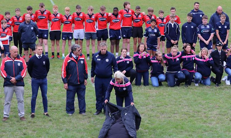 Players observe a minute's silence at East Grinstead rugby club, Kent, to pay respects to Matt Ratana who was the club's head coach.