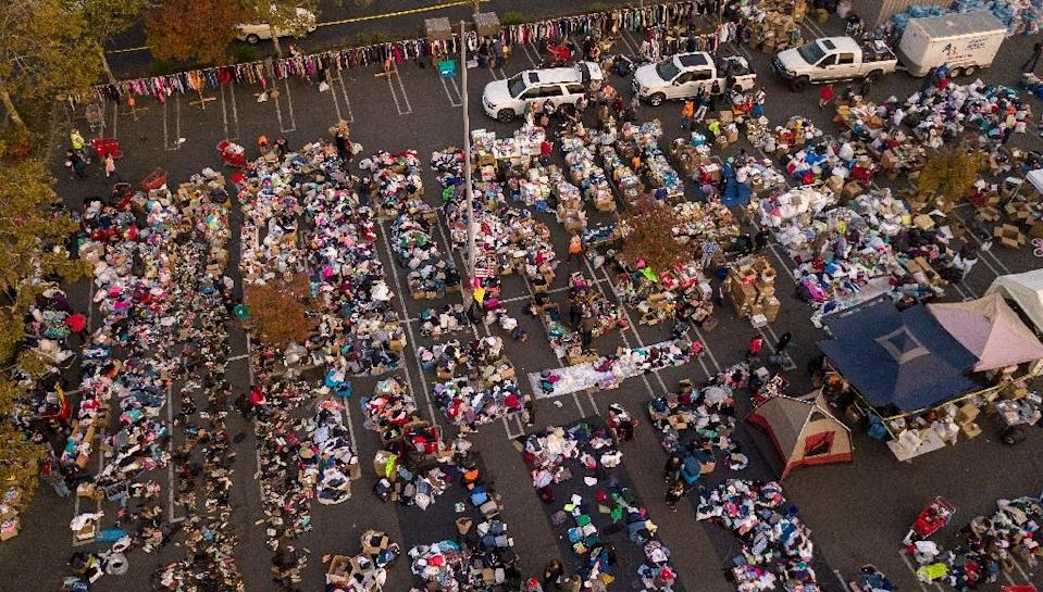 Fire evacuees sift through a surplus of donated items at a parking lot in Chico, California (AFP Photo/Josh Edelson)