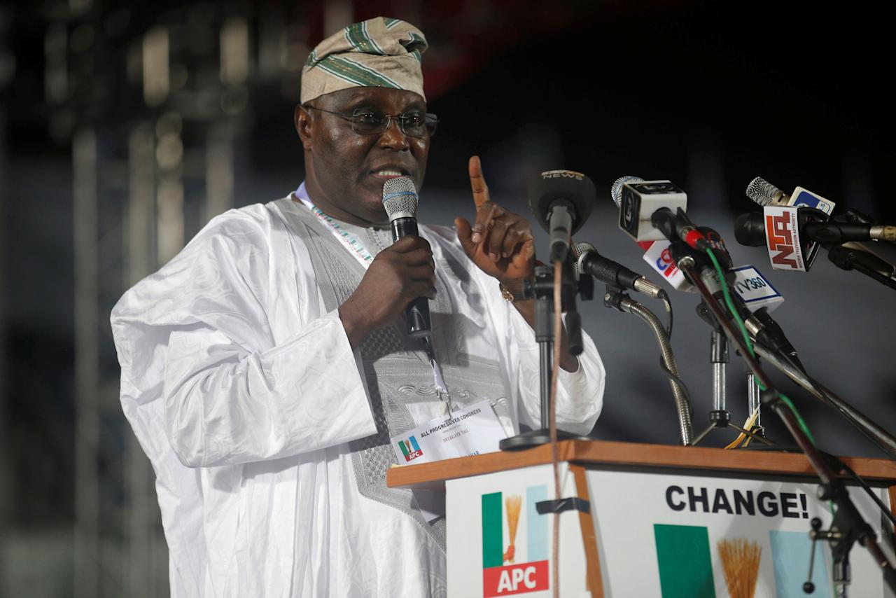 FILE PHOTO: Nigeria's former Vice-President Atiku Abubakar speaks as he presents his manifesto at All Progressives Congress (APC) party convention in Lagos early December 11, 2014. REUTERS/Akintunde Akinleye/File Photo