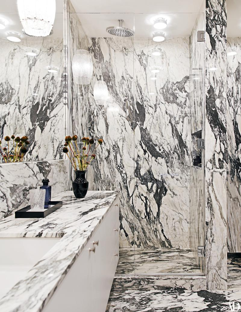 The calacatta paonazzo marble–clad master bath.