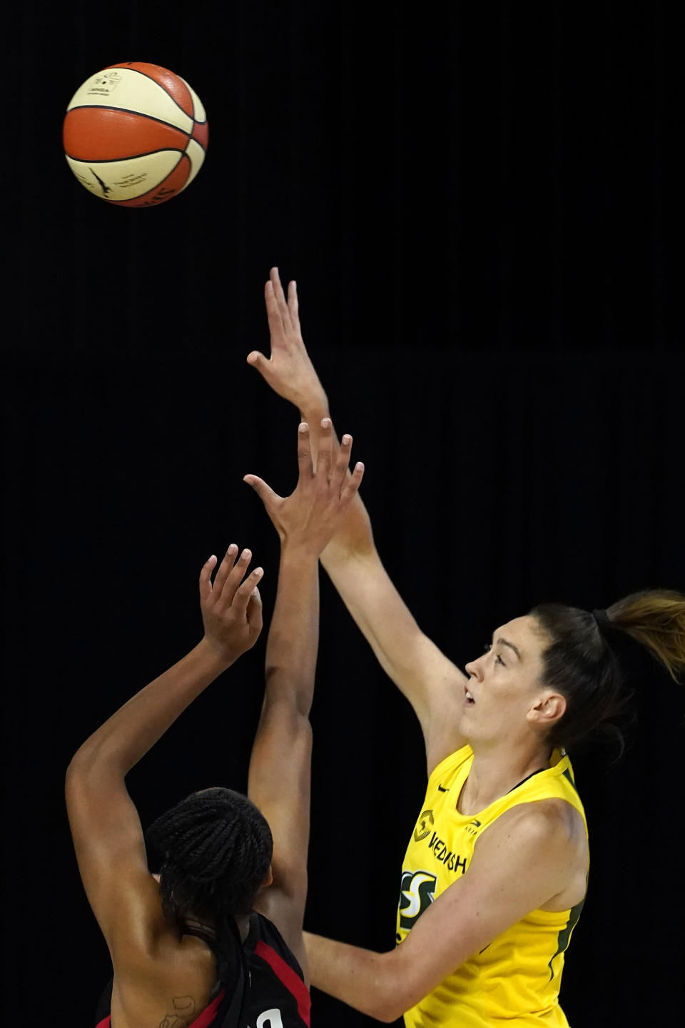 Seattle Storm forward Breanna Stewart (30) shoots over Las Vegas Aces guard Jackie Young during the first half of Game 1 of basketball's WNBA Finals Friday, Oct. 2, 2020, in Bradenton, Fla. (AP Photo/Chris O'Meara)