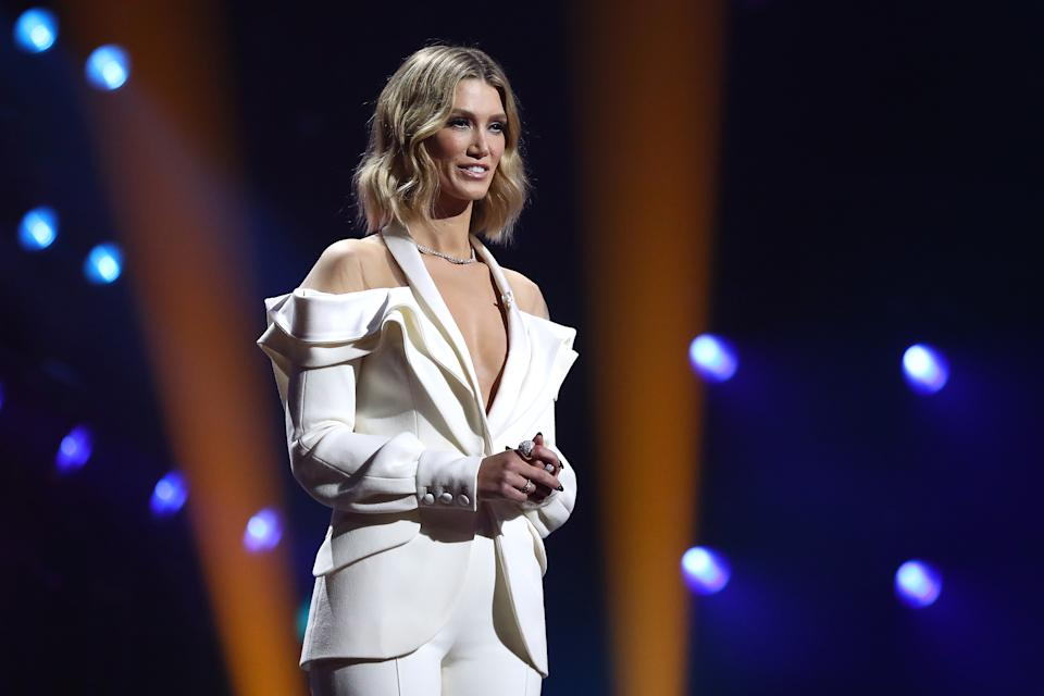 Host Delta Goodrem wears a white suit on stage while hosting the 2020 ARIA Awards at The Star on November 25, 2020 in Sydney, Australia.