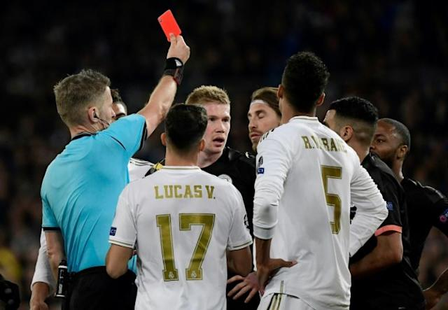 Real Madrid's Sergio Ramos (centre) is given a red card by referee Daniele Orsato against Manchester City (AFP Photo/JAVIER SORIANO)