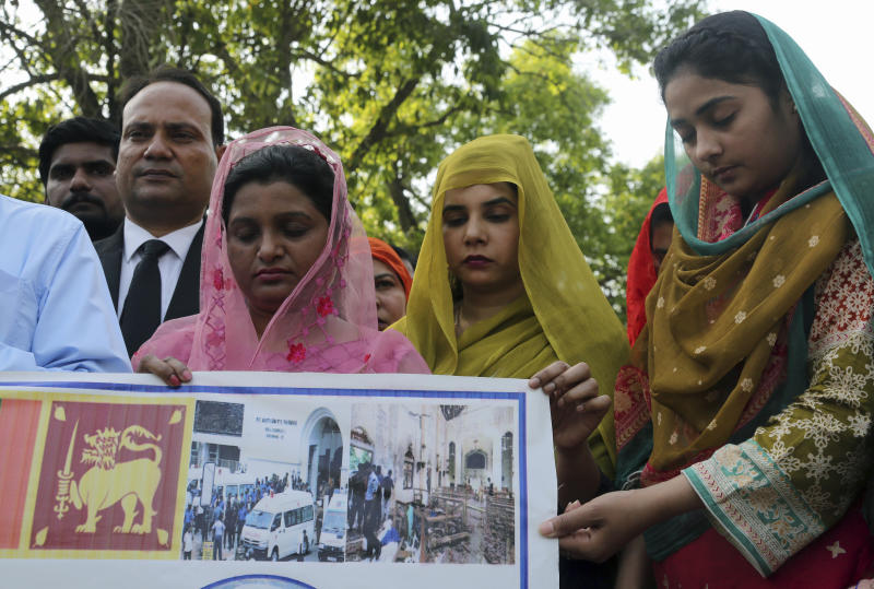 People attend special prayers for the victims of bomb explosions in churches and hotels in Sri Lanka, in Lahore, Pakistan, Monday April 22, 2019. (AP Photo/K.M. Chaudary)