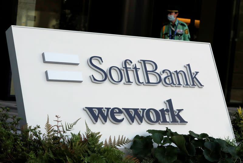 The logos of SoftBank and WeWork are displayed in front of SoftBank's new headquarters building in Tokyo