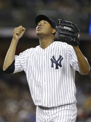New York Yankees starting pitcher Ivan Nova reacts after Baltimore Orioles' Adam Jones was thrown out at first base during the ninth inning of a baseball game on Friday, July 5, 2013, in New York. (AP Photo/Frank Franklin II)