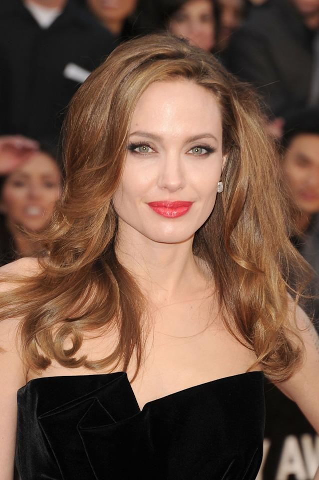 <p>While the rest of the world was looking at her leg pop, we were fixated on Jolie's glossy pink-red lipstick and bombshell waves. The actress had finally nailed effortless Hollywood beauty.</p>