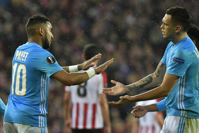 Marseille's Lucas Ocampos, right, congratulates Marseille's Dimitri Payet after Payet scored his side opening goal during their Europa League round of 16, 2nd leg, match between Athletic Bilbao and Olympique Marseille, at San Mames stadium, in Bilbao, northern Spain, Thursday, March 15, 2018. (AP Photo/Alvaro Barrientos)