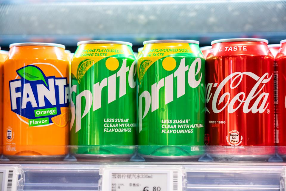 SHENZHEN, CHINA - 2020/10/05: Cans of Coca-Cola, Sprite and Fanta, beverages produced by the Coca-Cola Company, seen displayed in a supermarket. (Photo by Alex Tai/SOPA Images/LightRocket via Getty Images)