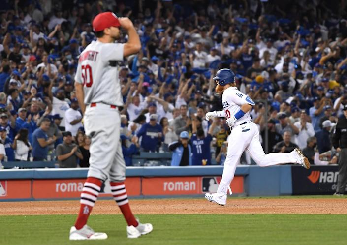 Los Angeles Dodgers' Justin Turner rounds the bases after hitting a solo home run to tie the game