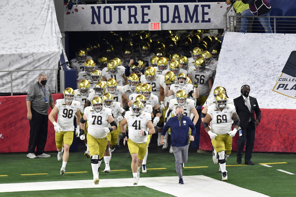 ARLINGTON, TEXAS - JANUARY 01: Head coach Brian Kelly and the Notre Dame Fighting Irish football players run on the field during player introductions before the College Football Playoff Semifinal at the Rose Bowl football game against the Alabama Crimson Tide at AT&T Stadium on January 01, 2021 in Arlington, Texas. The Alabama Crimson Tide defeated the Notre Dame Fighting Irish 31-14. (Photo by Alika Jenner/Getty Images)