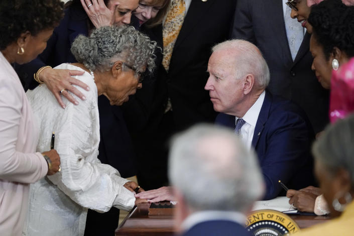 President Joe Biden speaks with Opal Lee after he signed the Juneteenth National Independence Day Act, in the East Room of the White House, Thursday, June 17, 2021, in Washington. (AP Photo/Evan Vucci)