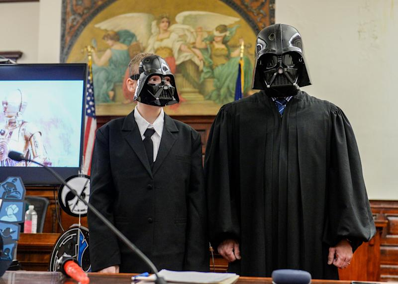 Alexander Reyes, age 12, and Judge Greg Pinski, both dressed as Darth Vader, pose for photos after Reyes' Star Wars-themed adoption ceremony at the Cascade County Courthouse. Alex, a huge fan of Darth Vader, was officially adopted by Philip and Pamela Reyes on Friday.