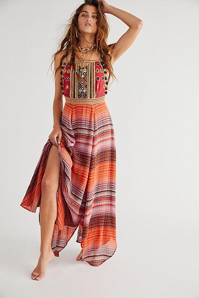 """<br><br><strong>Free People</strong> Regina Midi Dress, $, available at <a href=""""https://go.skimresources.com/?id=30283X879131&url=https%3A%2F%2Fwww.freepeople.com%2Fshop%2Fregina-midi-dress2%2F"""" rel=""""nofollow noopener"""" target=""""_blank"""" data-ylk=""""slk:Free People"""" class=""""link rapid-noclick-resp"""">Free People</a>"""