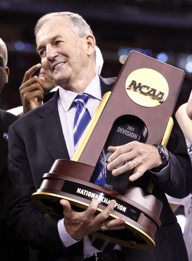 Huskies head coach Calhoun holds the NCAA trophy after the Huskies defeated the Bulldogs in their men's final NCAA Final Four College Championship basketball game in Houston