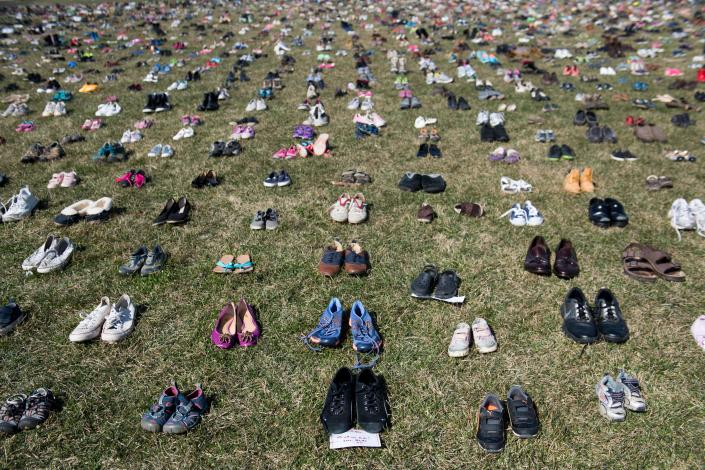"""7,000 pairs of shoes are displayed on the grass outside the U.S. Capitol on March 13, 2018, to memorialize the children killed in gun violence since the Sandy Hook school shooting.<span class=""""copyright"""">Saul Loeb—AFP/Getty Images</span>"""