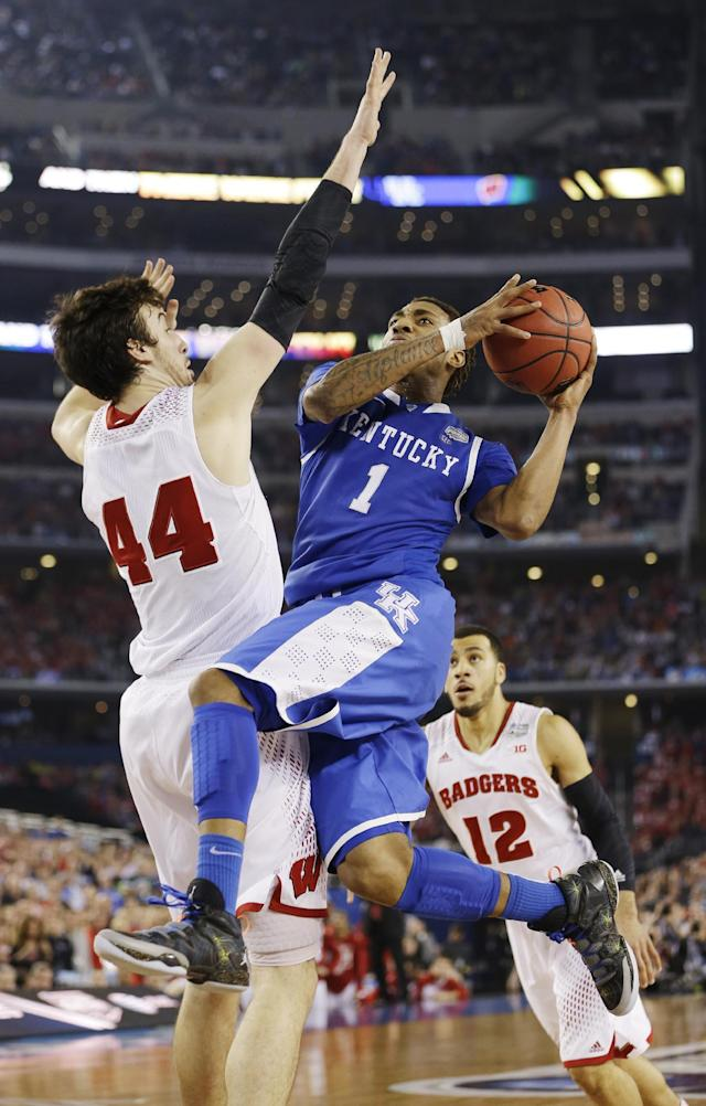 Kentucky guard James Young (1) shoots as Wisconsin forward Frank Kaminsky (44) defends during the second half of the NCAA Final Four tournament college basketball semifinal game Saturday, April 5, 2014, in Arlington, Texas. (AP Photo/David J. Phillip)