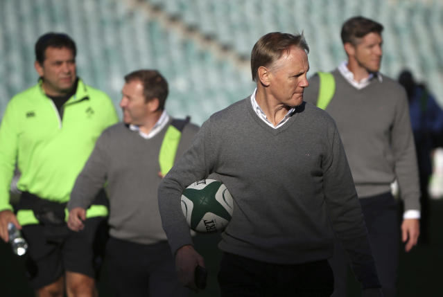 Ireland's head coach, Joe Schmidt, second right, arrives for their captain's run training session in Sydney, Friday, June 22, 2018, ahead of their rugby union test match against Australia. Ireland will play Australia in Sydney on Saturday. (AP Photo/Rick Rycroft)