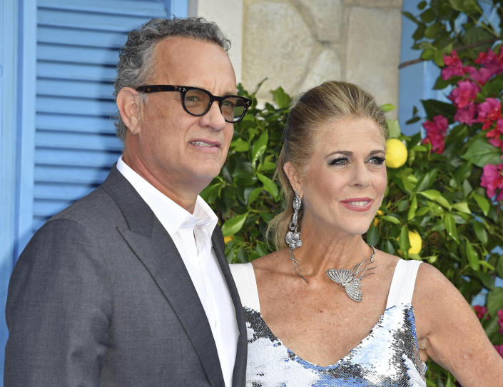"""March 11th 2020 - Tom Hanks and Rita Wilson have tested positive for the novel coronavirus. - File Photo by: zz/KGC-143/STAR MAX/IPx 2018 7/16/18 Tom Hanks and Rita Wilson at the premiere of """"Mamma Mia! Here We Go Again"""" in London, England, UK."""