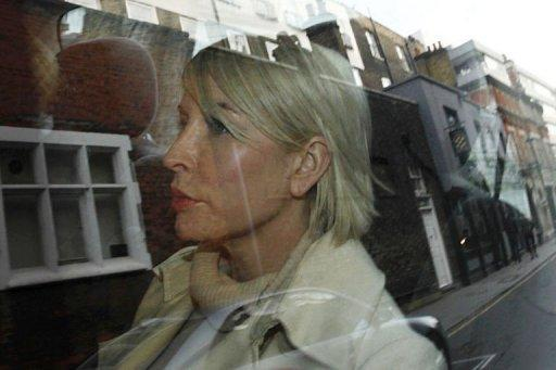 Former wife of Paul McCartney, Heather Mills, leaves the Royal Courts of Justice in a taxi. Mills told the Leveson Inquiry that voicemail messages from the Beatles singer were hacked, slamming suggestions she had leaked them to journalists herself