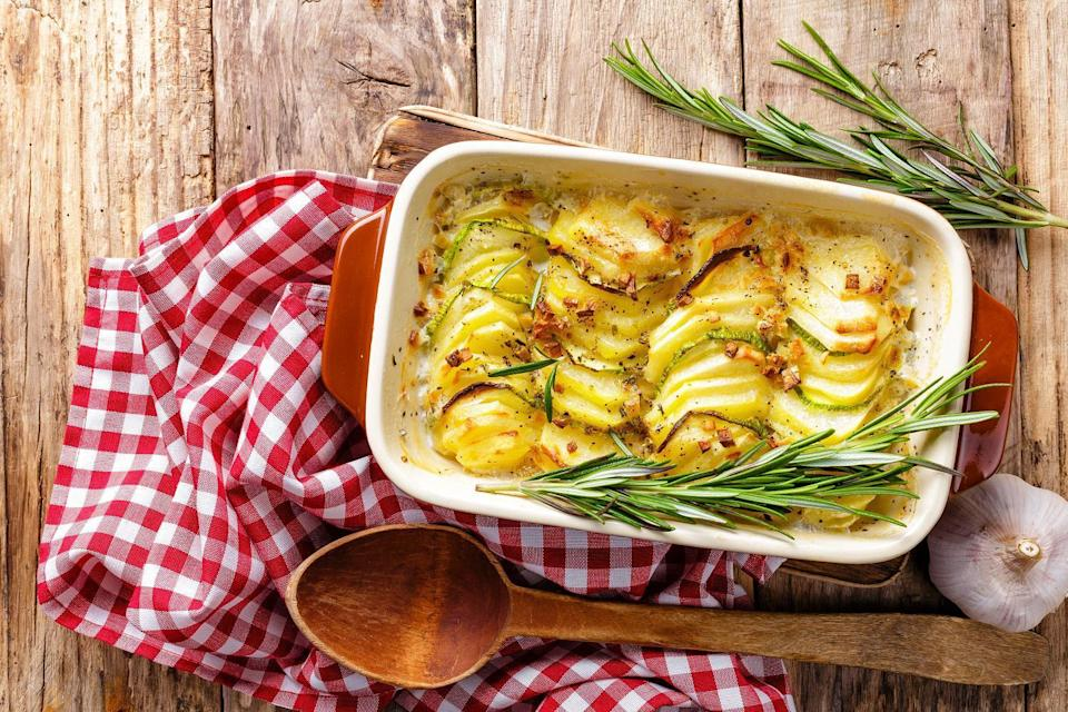 """<p>One of <a href=""""https://www.thedailymeal.com/cook/50-great-ways-cook-potatoes-0?referrer=yahoo&category=beauty_food&include_utm=1&utm_medium=referral&utm_source=yahoo&utm_campaign=feed"""" rel=""""nofollow noopener"""" target=""""_blank"""" data-ylk=""""slk:our all-time favorite potato side dishes"""" class=""""link rapid-noclick-resp"""">our all-time favorite potato side dishes</a>, scalloped potatoes pair well with just about anything, from <a href=""""https://www.thedailymeal.com/cook/prime-rib-recipes-tips-how-to?referrer=yahoo&category=beauty_food&include_utm=1&utm_medium=referral&utm_source=yahoo&utm_campaign=feed"""" rel=""""nofollow noopener"""" target=""""_blank"""" data-ylk=""""slk:prime rib"""" class=""""link rapid-noclick-resp"""">prime rib</a> to grilled chicken to barbecued ribs.</p> <p><a href=""""https://www.thedailymeal.com/recipes/scalloped-golden-potatoes-rosemary-and-thyme-recipe?referrer=yahoo&category=beauty_food&include_utm=1&utm_medium=referral&utm_source=yahoo&utm_campaign=feed"""" rel=""""nofollow noopener"""" target=""""_blank"""" data-ylk=""""slk:For the Scalloped Golden Potatoes With Rosemary and Thyme recipe, click here."""" class=""""link rapid-noclick-resp"""">For the Scalloped Golden Potatoes With Rosemary and Thyme recipe, click here.</a></p>"""