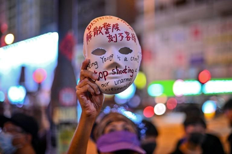 Hong Kong's leader outlawed face coverings at protests, invoking colonial-era emergency powers not used for half a century (AFP Photo/Philip FONG)