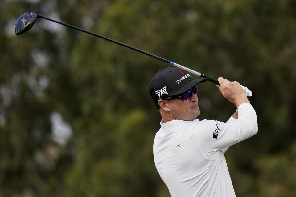 Zach Johnson watches his tee shot on the fourth hole during the first round of the PGA Championship golf tournament at TPC Harding Park Thursday, Aug. 6, 2020, in San Francisco. (AP Photo/Jeff Chiu)