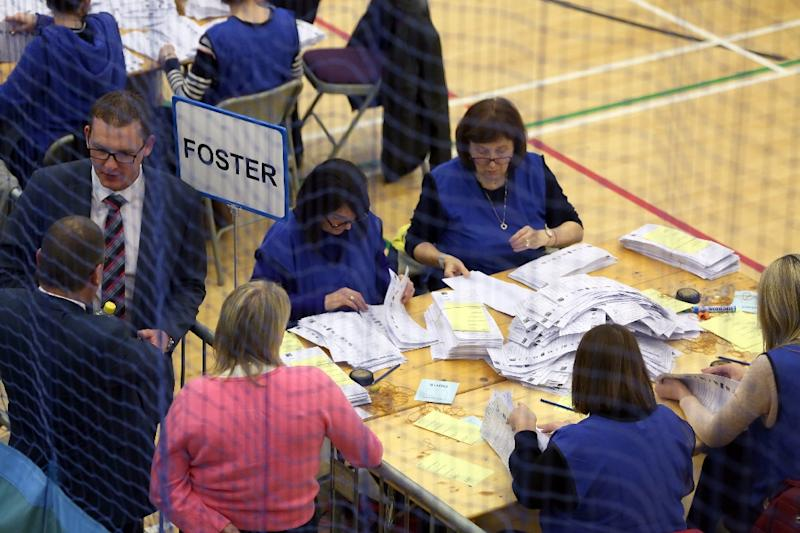 Final results from Northern Ireland's elections showed the Democratic Unionist Party with 28 seats and Sinn Fein 27 in the province's semi-autonomous 90-seat parliament (AFP Photo/Paul FAITH)