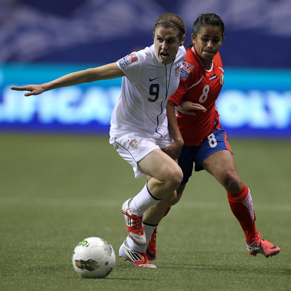 United States' Heather O'Reilly (9) fights for control of the ball with Costa Rica's Daniela Cruz (8) during the second half of CONCACAF women's Olympic qualifying soccer game action at B.C. Place in Vancouver, British Columbia, Friday, Jan. 27, 2012. (AP Photo/The Canadian Press, Jonathan Hayward)
