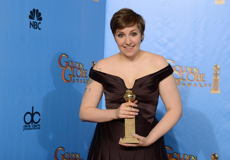 """Actress, writer and director Lena Dunham poses with the award for best television series - comedy or musical for """"Girls"""" backstage at the 70th Annual Golden Globe Awards at the Beverly Hilton Hotel on Sunday Jan. 13, 2013, in Beverly Hills, Calif. (Photo by Jordan Strauss/Invision/AP)"""