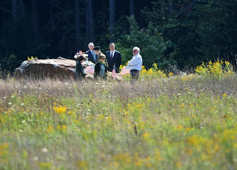Defense Secretary Leon Panetta, center, Patrick White, a representative of victim's families, second from left, and others, visit the crash site at a day ahead of the 11th anniversary of the 9/11 attacks, Monday, Sept. 10, 2012, in Shanksville, Pa. (AP Photo/Mandel Ngan, Pool)